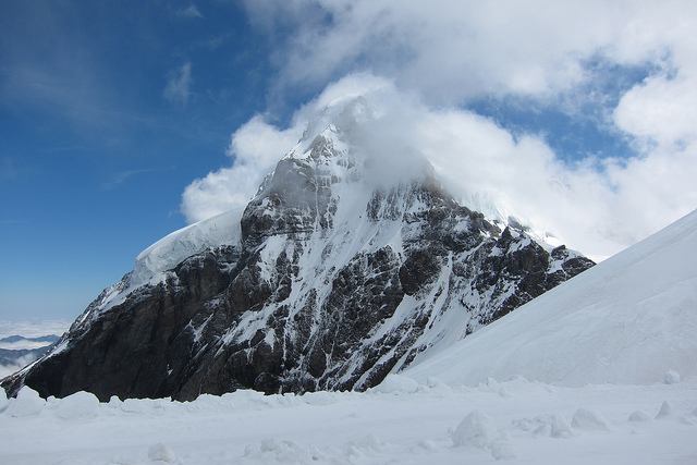 the Eiger mountain with snow and clouds
