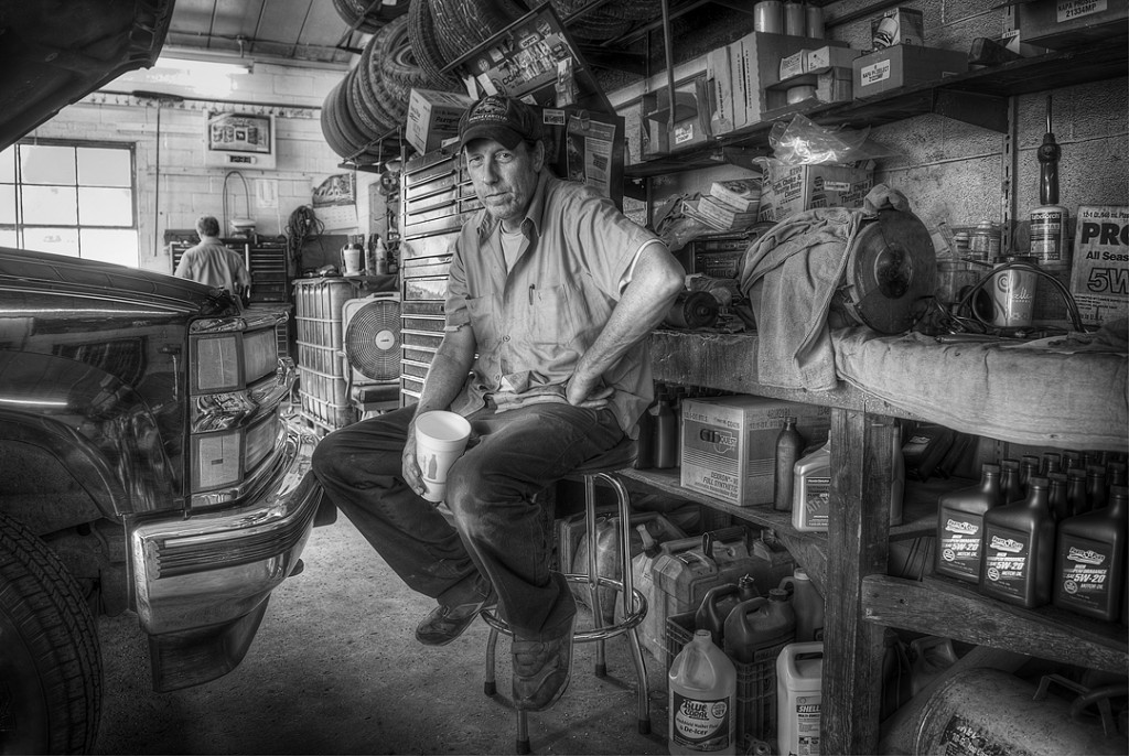 black and white photo of a car mechanic