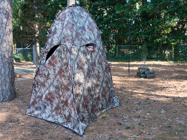 camouflage bird blind with person looking out